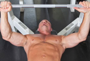 man on bench press